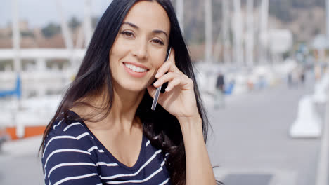 Attractive-smiling-woman-using-a-mobile-phone