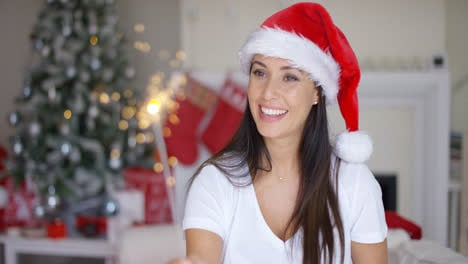 Festive-young-woman-in-red-Santa-Claus-hat