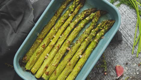 Close-up-with-selective-focus-on-roasted-asparagus-seasoned-with-salt-pepper-garlic-
