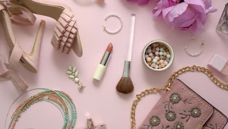 Beauty-and-fashion-accessories-and-gadgets-Femine-concept-Flat-lay-on-pink-theme-background