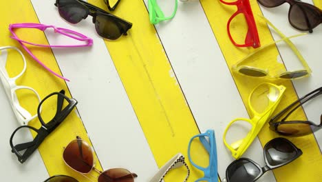 Composition-of-various-style-and-color-sunglasses-and-frames-captured-from-above-