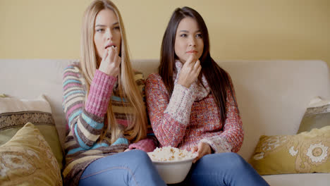 Girls-Eating-Popcorn-While-Watching-Movie-at-Home