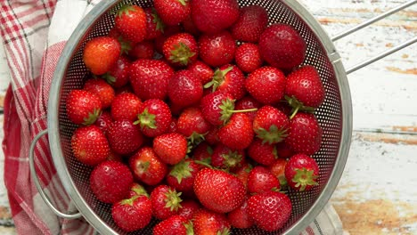 Delicious-healthy-fresh-strawberries-placed-in-metal-strainer-Organic-natural-food-concept-