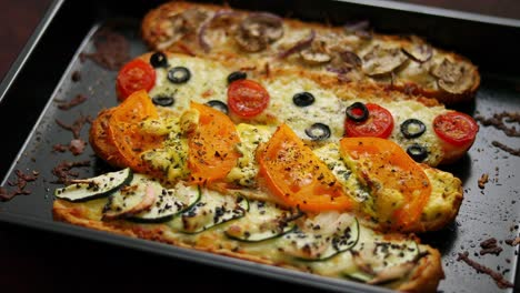 Delicious-hot-sandwich-baguettes-baked-with-tuna-cheese-tomatoes-olives-courgette-and-mushrooms