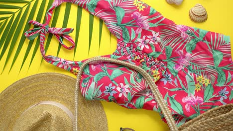 Female-beach-summer-clothes-and-accessories-collage-on-yellow-background