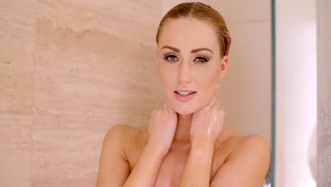 Naked-Woman-in-a-Shower-with-Hands-Behind-her-Neck