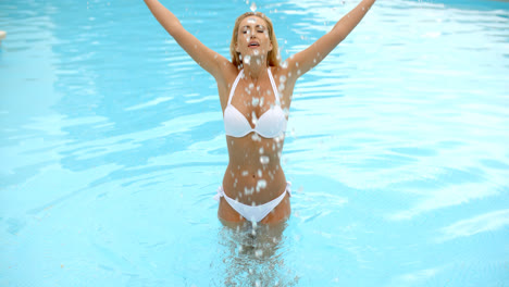 Woman-in-White-Bikini-Splashing-Water-in-a-Pool