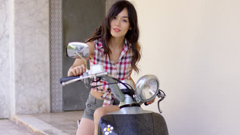Attractive-young-woman-on-a-motorcycle