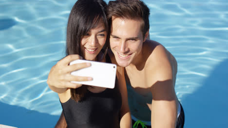 Handsome-couple-take-photo-while-standing-in-pool