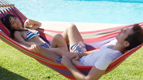 Young-couple-relaxing-in-a-hammock