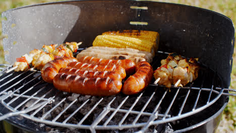 Sausages-corncobs-and-kebabs-grilling-on-a-BBQ
