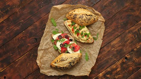 Healthy-food-concept-Sandwiches-with-hummus-mozarella-tomato-black-olives