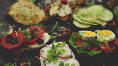 Assortment-of-home-made-sandwiches-with-various-toppings-With-colorful-fresh-vegetables