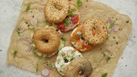 Circular-bread-bagel-sandwich-served-with-various-toppings-Samlon-ham-and-cheese-cottage-hummus