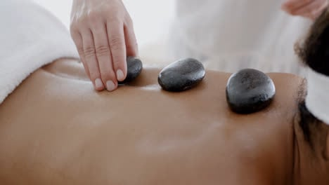Woman-Receiving-A-Massage-With-Hot-Stone