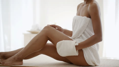 Woman-Massaging-Leg-In-Spa