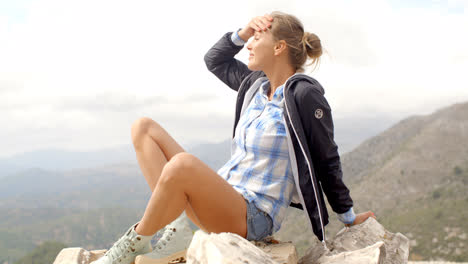 Fit-Woman-Resting-at-Rock