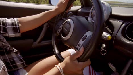 Young-Woman-Driving-A-Cabriolet-