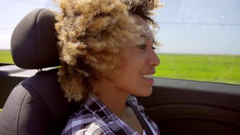 A-Young-Black-Woman-Driving-A-Cabriolet-In-Summer