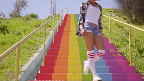 Young-Woman-Walks-Down-The-Colorful-Stairs-