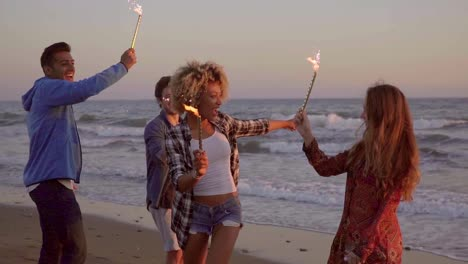 Young-People-With-Fountain-Candles-On-The-Beach