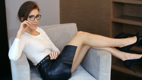 Sexy-Business-Woman-Resting-on-Armchair