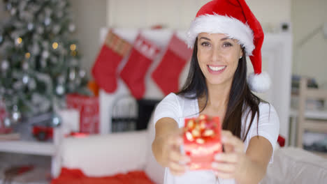 Gorgeous-young-woman-offering-an-Xmas-gift