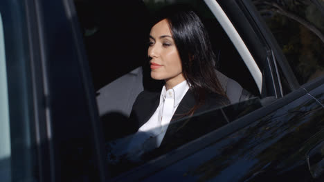Beautiful-young-executive-sitting-in-limousine