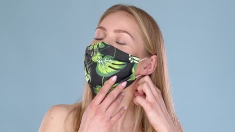 Adorable-young-girl-taking-off-her-face-mask-against-viruses-with-huge-relief-