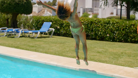 Sexy-Girl-in-Bikini-Doing-Back-Flip-into-Pool