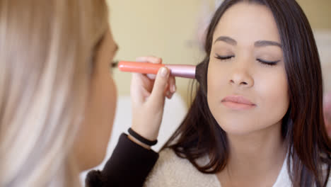 Female-cosmetician-working-with-client