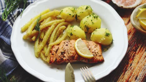 Fresh-and-tasty-baked-salmon-served-with-young-boiled-potatoes-and-yellow-bean