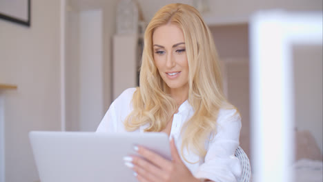 Happy-Blond-Woman-Using-her-Laptop-Computer