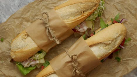 Tasty-homemade-sandwiches-Baguettes-with-various-healthy-ingredients-Breakfast-take-away-concept