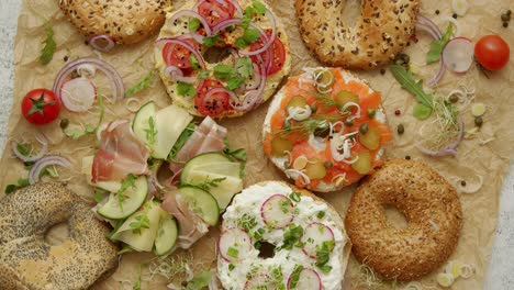 Tasty-colorful-various-bagels-with-healthy-ingredients-served-on-brown-baking-paper