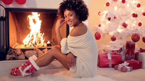 Cute-young-woman-warming-herself-at-the-fire