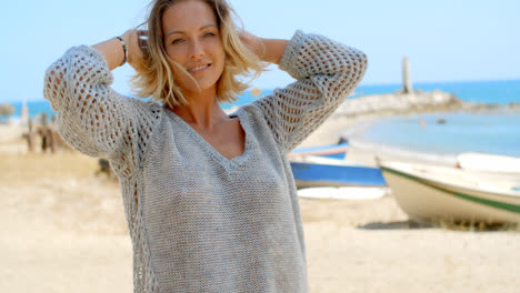 Woman-in-Grey-Sweater-on-Beach-with-Fishing-Boats