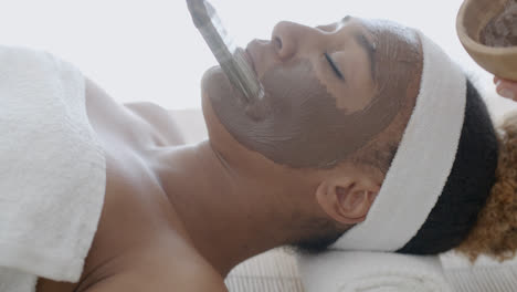 Woman-With-Clay-Facial-Mask-In-Spa