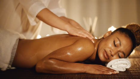 Woman-Having-Therapy-Massage-Of-Back