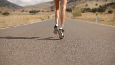 Fit-Girl-Running-on-Mountain-Road