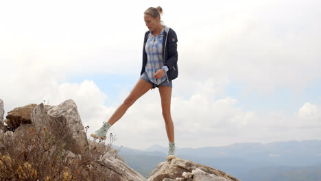Sporty-Woman-Standing-on-Top-of-Rock