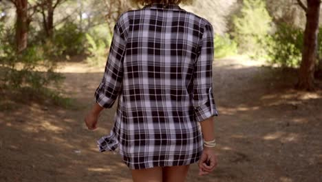 Woman-in-Plaid-Shirt-Walking-on-Forest-Trail
