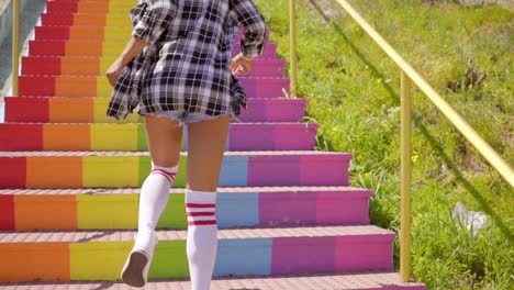 Young-Woman-Running-Up-The-Stairs-