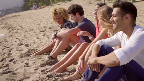 Group-of-multiracial-people-sitting-on-a-beach