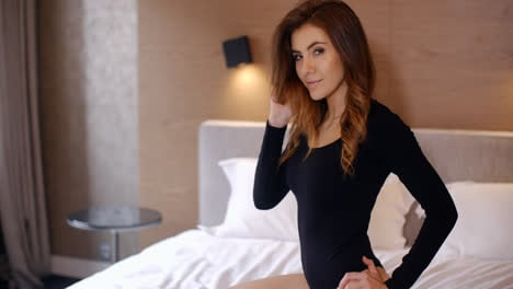 Sensual-Woman-Kneeing-on-Bed