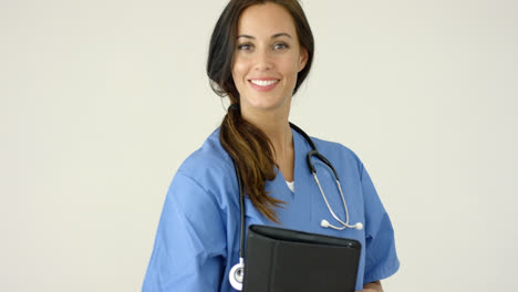 Smiling-young-female-physician-smiles-at-camera