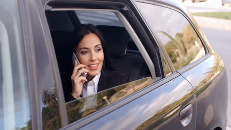 Curious-business-woman-on-phone-looking-from-car