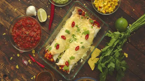 Vegetable-Burritos-served-in-glass-heatproof-dish-With-salsa-guacamole-nachos-and-ingredients