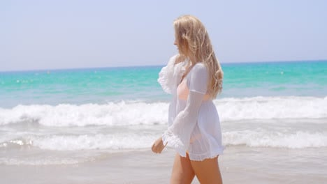 Blond-Girl-Walking-in-White-Tunic-on-the-Beach
