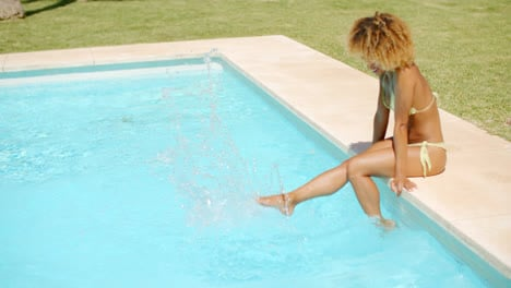Girl-Sitting-At-the-Edge-of-Swimming-Pool